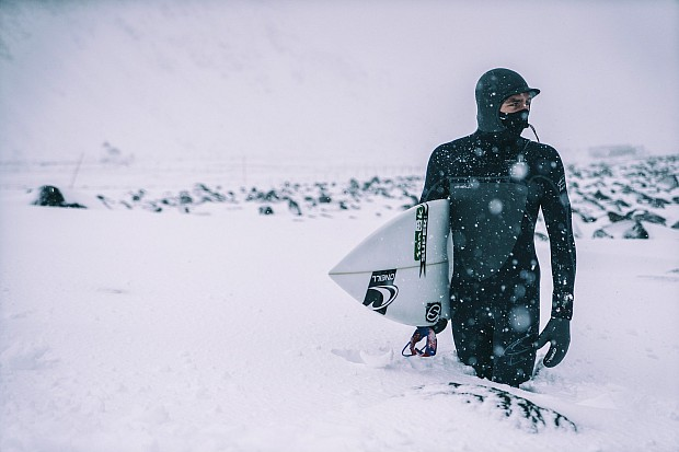 """""""Brett pauses during the snowy walk to the ocean to survey the waves."""""""