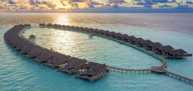 anantara-kihavah-over-water-villas-sunset-aerial